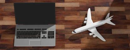 Kommersiellt flygplan och en bärbar dator, på trägolvbakgrund, bästa sikt illustration 3d royaltyfri illustrationer