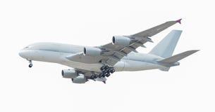 Kommersiellt flygplan som isoleras på vit bakgrund med banan Fotografering för Bildbyråer