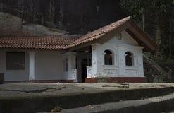 Kommet att vagga huset från vagga grottan Royaltyfri Bild