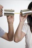 Kommunikation med tincans Arkivfoto