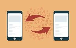 Kommunikations- och datasynkronisering mellan mobiltelefoner. Arkivbilder