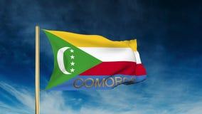 Komoren-Flaggenschieberart mit Titel Herein wellenartig bewegen stock video footage