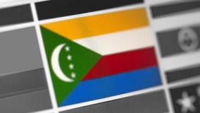 Komoren-Staatsflagge des Landes Komoren-Flagge auf der Anzeige, ein digitaler Wässerungseffekt lizenzfreies stockfoto