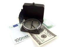 Kompaß auf Geld Lizenzfreies Stockbild