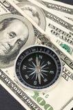 Kompaß und Dollar Stockfotografie