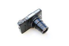 Kompakt digital kamera och lins Arkivfoto