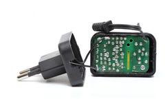 Kompakt strömförsörjning Arkivfoto