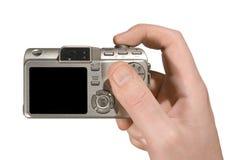 Kompakte Kamera in der Hand Lizenzfreie Stockfotos