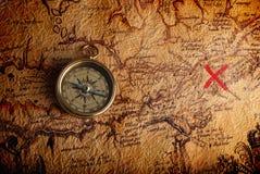 Kompas en een kaart Royalty-vrije Stock Afbeeldingen