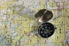Kompas en een kaart Stock Foto