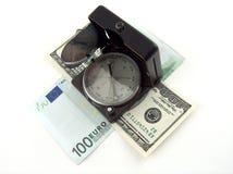 Kompas en geld Royalty-vrije Stock Foto's