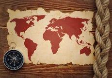 Kompas en kabel op kaart Stock Foto