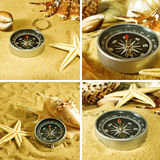 Kompas en overzeese shells op het zand sluiten omhoog Stock Foto's