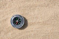 Kompas in het Zand Stock Afbeeldingen