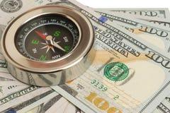 kompas op de grote bankbiljetten stock afbeelding