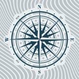 Kompas wzrastał nad tłem z fala Fotografia Royalty Free