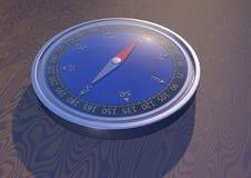 Kompass auf dem Tisch Lizenzfreie Stockfotografie