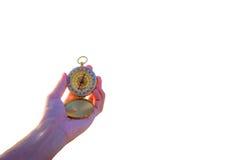 Kompass in der Hand auf Weiß Lizenzfreie Stockfotografie