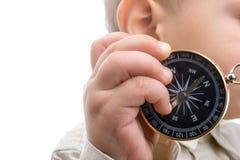 Kompass in der Hand des Babys Stockfoto