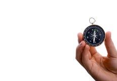 Kompass in der Kinderhand Stockfotografie