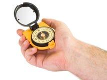 Kompass i gömma i handflatan Arkivfoto