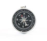 Kompass med den snabba banan Arkivfoto