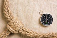 Kompass med ett rep Arkivbilder