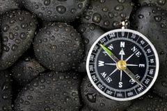 Kompass med rocken Arkivfoto
