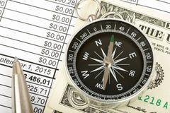 Kompass mit Bargeld Stockbilder