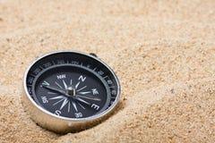 Kompass på den varma sanden Fotografering för Bildbyråer