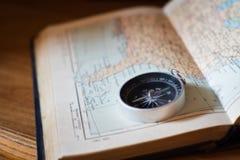 Kompass på en världskarta Royaltyfria Foton