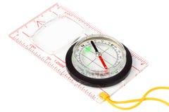 Kompass på en vit bakgrund Arkivbilder