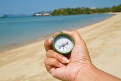 kompasshandholding Arkivfoto