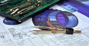 Kompassse und die Zeichnung Stockfotografie