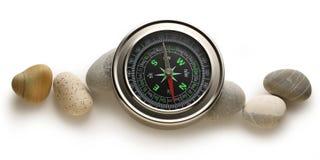 Kompasu i morza kamienie Zdjęcie Stock