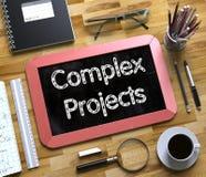 Komplexprojekt - text på den lilla svart tavlan 3d Arkivbilder