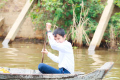 KOMPONG PHLUK, CAMBODIA - OCTOBER 24: Boy of Kompong Phluk rowing boats to come home from school on October 21, 2015 in Kompong Ph Royalty Free Stock Image