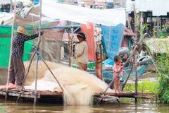 KOMPONG PHLUK, CAMBODIA - OCTOBER 24: Kompong Phluk homes with children helping fishing on October 21, 2015 in Kompong Phluk, Camb Royalty Free Stock Image