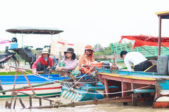 KOMPONG PHLUK, CAMBODIA - OCTOBER 24: Unidentified local people, await tourists on boats to take them to the floating village of K Royalty Free Stock Photos