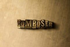 KOMPONIST - Nahaufnahme des grungy Weinlese gesetzten Wortes auf Metallhintergrund Stockbilder