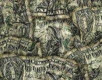 Komposit av skrynkliga vikta dollarräkningar Arkivbild