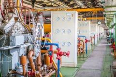 Kompressor- och samlaremaskin i fabrik Royaltyfria Foton
