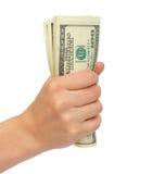 Komprimiertes Bündel Dollar eine weibliche Hand Lizenzfreie Stockfotografie