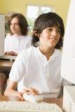 komputer frontu szkoły studencikiem nauki Zdjęcia Royalty Free