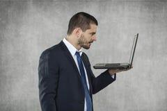 Komputer przy pracą, biznesowy mężczyzna fotografia stock