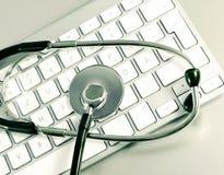 Komputerowa klawiatura i medyczny stetoskop Zdjęcie Royalty Free