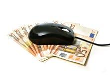 Komputerowa mysz na banknotach obrazy stock