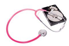 komputerowy dysk twardy z różowym stetoskopem obraz royalty free