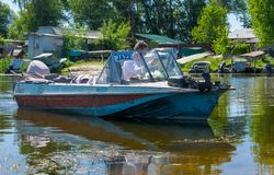 Old fishing boat and swampy banks of the Dnieper River. Fishing in Eastern Europe Royalty Free Stock Images