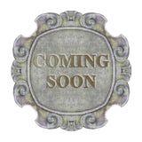 Komst spoedig concept op een oud gesneden steenkader wordt geschreven - conceptenbeeld dat royalty-vrije stock foto